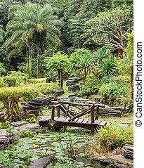 Ornamental garden with foot bridge over a pond