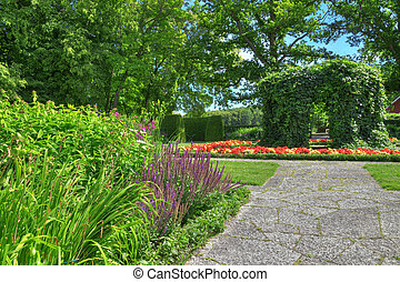 Ornamental garden with stone paths in summer.