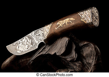 Ornamental hunting knife. - Details of elaborate wildlife...