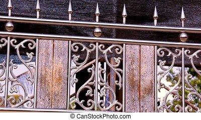 Ornamental metal fence. Video shift motion - Ornamental...