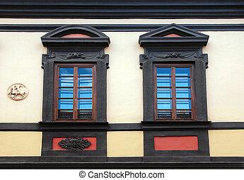 Ornamental wooden windows of old buildings in Old Town of Vilnius