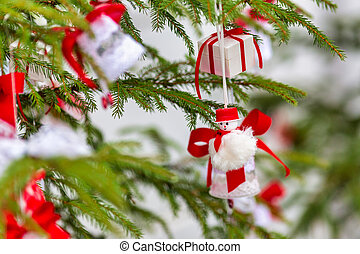 Ornaments hanging on a Christmas tree.