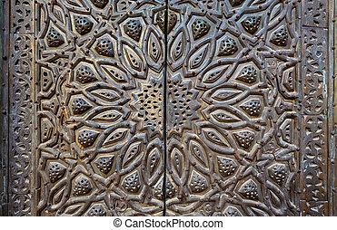 Ornaments of  bronze-plate ornate door
