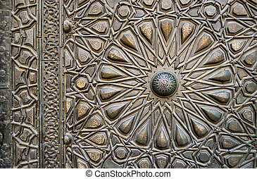 Ornaments of the bronze-plate door of an old mosque, Old Cairo,