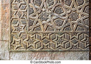 Ornaments of the bronze-plate door of an old mosque