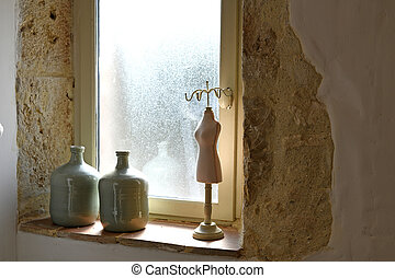 Ornaments on the window sill of a bathroom