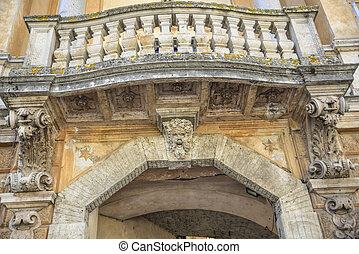 Ornate arch and loggia with columns. Orvieto, Italy - Ornate...