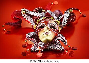 Ornate carnival mask over red background.