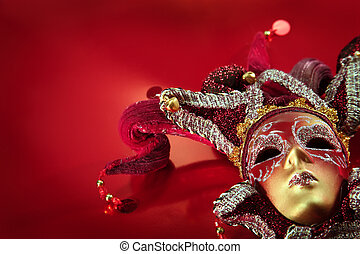 ornate carnival mask over textured metallic background