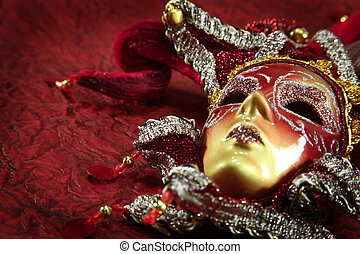 ornate carnival mask over red textured background