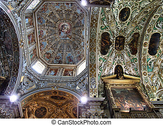 Richly ornamented cathedral ceiling. Ecclesiastical architecture in Italy.