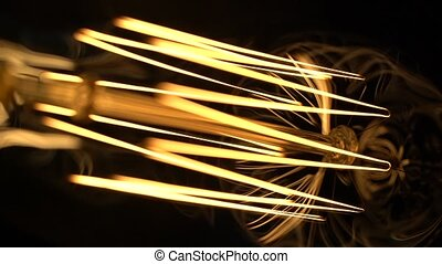 Ornate curves of incandescent tungsten - Macro shot of...
