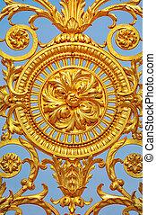 Ornate - Detail of golden door of Versailles Palace. France