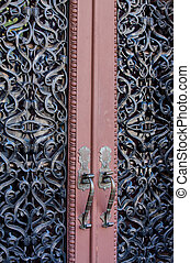 Ornate Doors - Ornate wrought iron imbedded double entry...