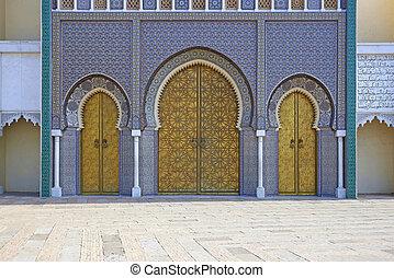 Royal Palace - Ornate entrance gates to the Royal Palace in...