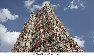 Ornate facade of Hindu temple in low angle