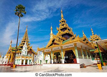 Ornate golden temple pavilion encircling the main structure...