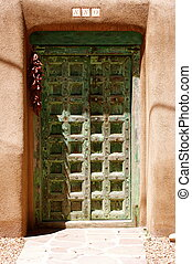 Ornate Green Adobe Doorway - Ornate green wooden doorway in...
