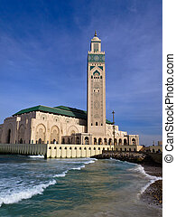 Ornate Hassan II Mosque against blue sky - View of Hassan II...