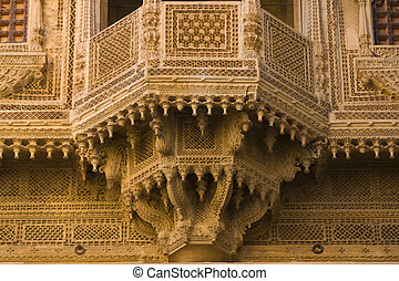 Ornate Merchants House - Delicate stone carved window of a...