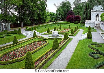 Ornate Park Garden - A fancy landscaped park or garden with...