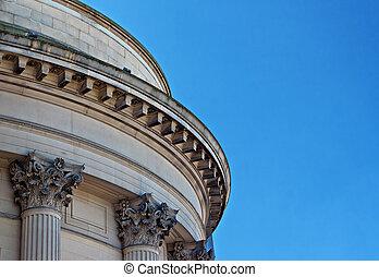 Ornate sandstone columns on government building