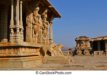 Ornate stone chariot in Hampi, India - Ornate stone chariot...