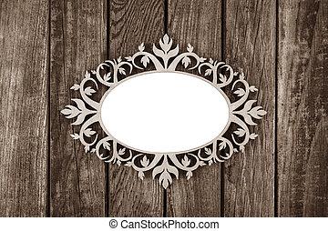 Ornate vintage frame on wooden background