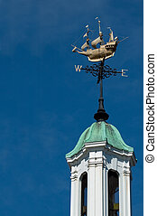 weather vane - ornate weather vane against blue sky
