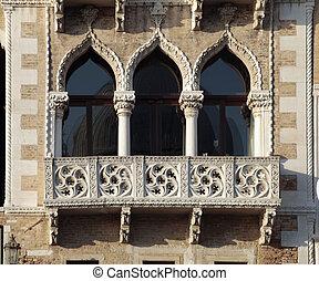 ornate windows and balcony in Venice, Italy.