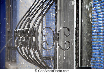 ornate wrought iron at the window
