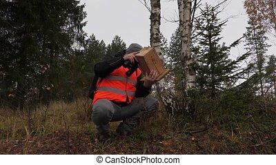 Ornithologe with bird nesting box