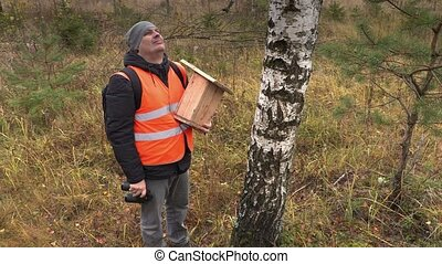Ornithologist with binoculars watching birds