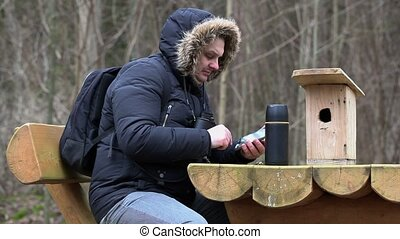 Ornithologist with tablet PC near table