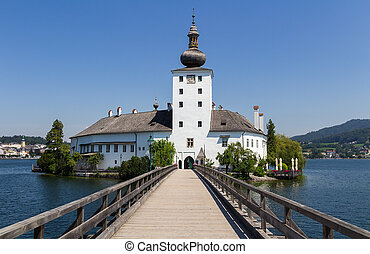 Ort castle with wooden bridge on traunsee lake. Austria summer landscape