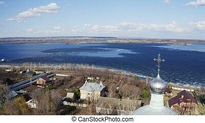 Orthodox Christians Church in village near river aerial view