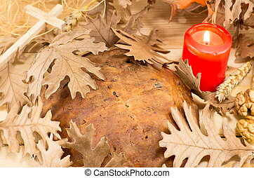 Orthodox Christmas bread covered with Yule log leaves - ...