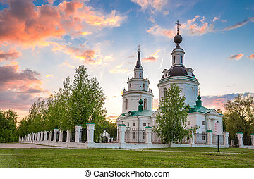 Clouds over Russian orthodox church at sunset. Bolshoe Boldino, Russia