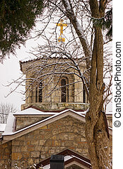 Orthodox Church in the city underthe snow