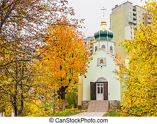 Orthodox church on a background of the construction autumn