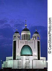 orthodox church with few golden cupola in the night...