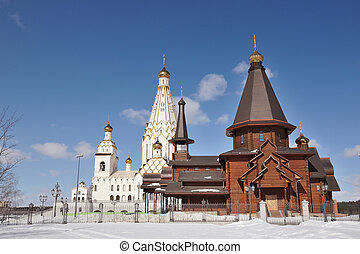 wooden and stone Orthodox Church buildings under clear blue sky; All Saints orthodox Church in Minsk, Belarus
