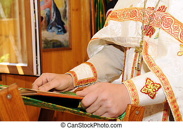 Orthodox clergyman reads - Orthodox clergymen read during a...
