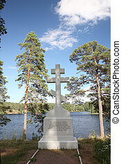 Orthodox cross on the bank of Lake Ladoga on the island of...