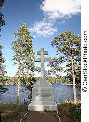 Orthodox cross on the bank of Lake Ladoga on the island of...