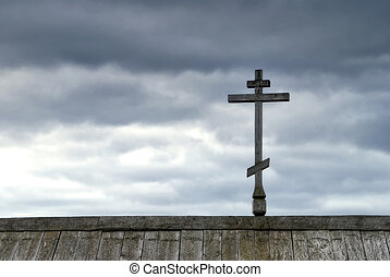 Orthodox cross on top of roof.