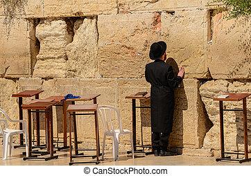 Orthodox Jewish man praying at the Western Wall in Jerusalem, Israel