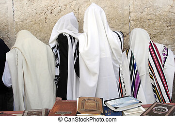 JERUSALEM - APRIL 07: Orthodox Jewish men Pray at the Western Wall during the Jewish holiday of Passover in Jerusalem, Israel. Passover commemorates the liberation of the Israelites from Egyptian slavery