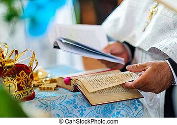 Orthodox priest during wedding ceremony.