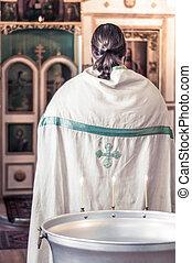 Orthodox priest in the Church of God in prayer